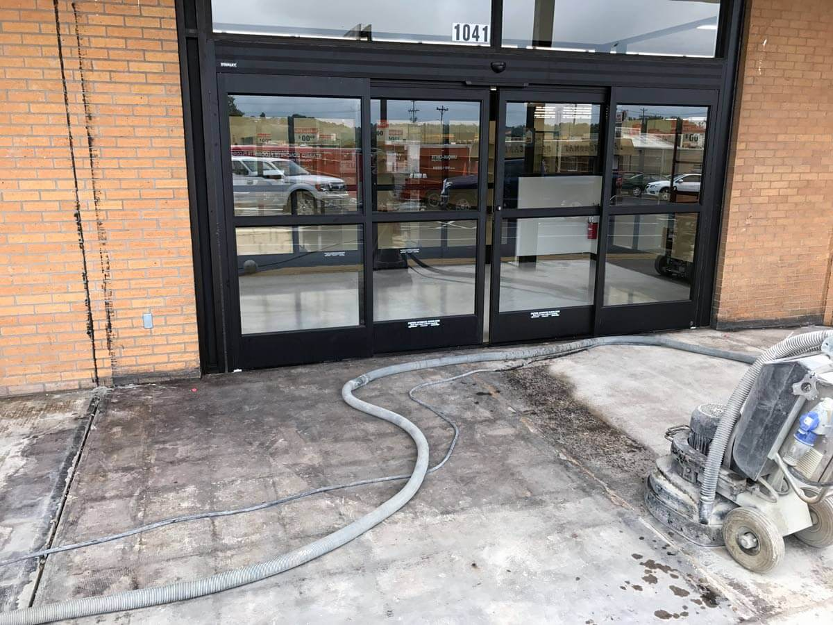 Big Lots front entrance, old concrete being removed.