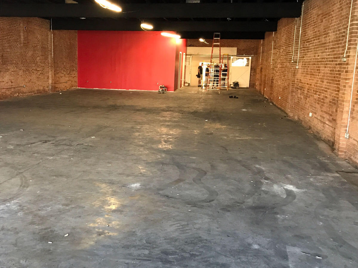 Portland Events & Party Center during construction, with ugly concrete floors.