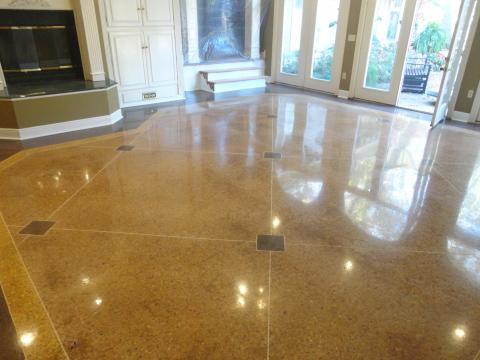 Stained and Scored concrete flooring at a residential home.